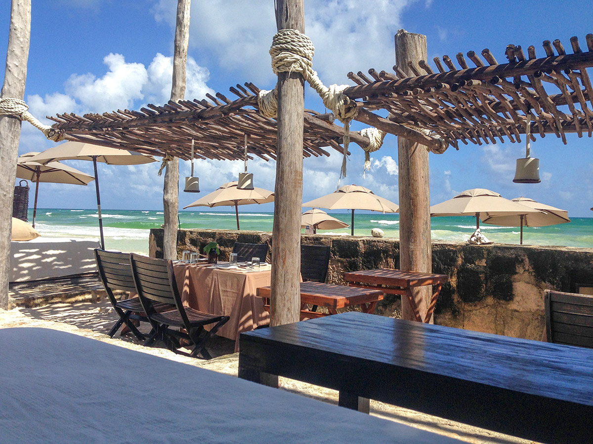 outdoor dining area at Coqui Coqui Tulum